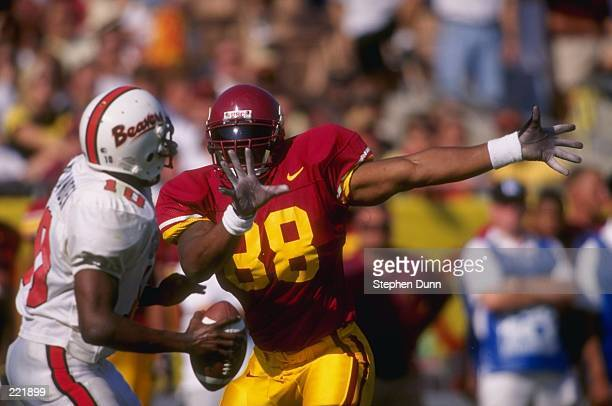 Defensive back George Perry of the USC Trojans throws his hands out as he pursues quarterback Tim Allyanden of the Oregon State Beavers for a sack...