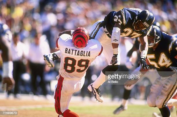 Defensive back Rodney Harrison of the San Diego Chargers leaves his feet as he attempts to break up a pass to tight end Marco Battaglia of the...
