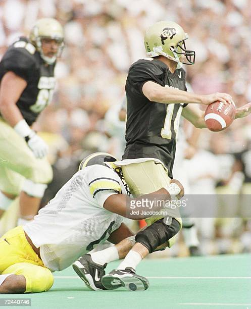 Defensive end David Bowens of the University of Michigan sacks quarterback Koy Detmer of the University of Colorado during the Wolverines 2013 win...