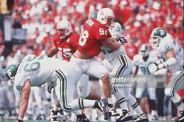Defensive end Grant Wistrom of the Nebraska Cornhuskers bull by a Michigan State linemen during the Cornhuskers 5514 win over the Spartans at...