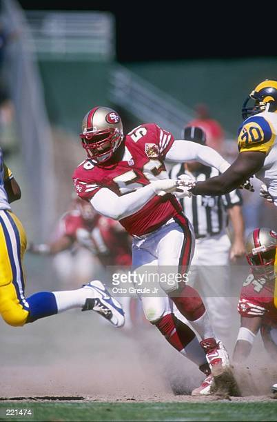 Defensive lineman Chris Doleman of the San Francisco 49ers pursues the football during the 49ers 340 victory over the St Louis Rams at 3Com park at...