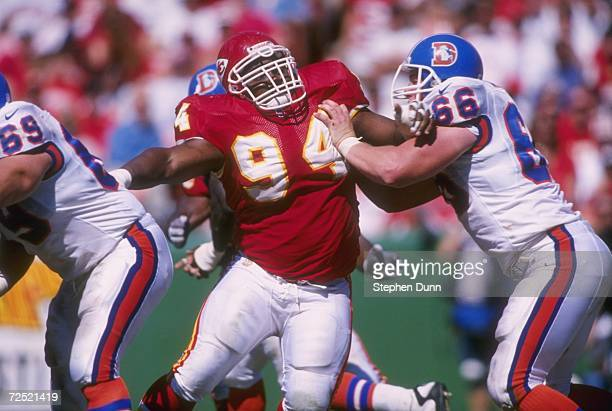 Defensvie lineman Keith Traylor of the Kansas City Chiefs stares into the back field as he uses his left arm to fight off an attempted block from...