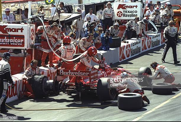 Driver Christian Fittapaldi of Brazil and the Newman Haas Racing team receives work on his Lola Ford 96 during a pit stop in the IndyCar PPG World...