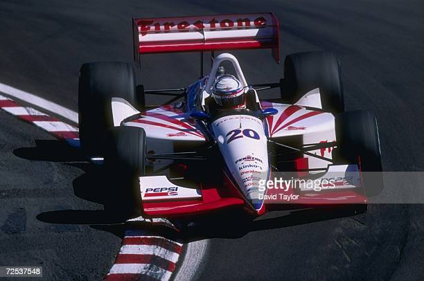 Driver Scott Pruett of the USA and team Patrick Racing rides up an embankment as he negotiates a turn while driving in his Lola T96 Ford race car...