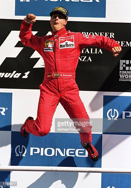 Ferrari driver Michael Schumacher of Germany jumps for joy on the podium after winning a stunning race after the Italian Formula One Grand Prix held...