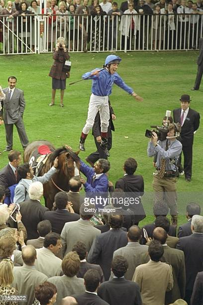 Frankie Dettori leaps off of Mark of Esteem after winning the Queen Elizabeth II stakes during his unique achievment of winning all seven races on...