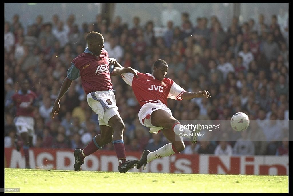 Ian Wright of Arsenal gets to the ball first : News Photo