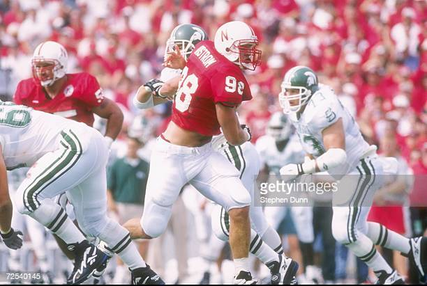 Linebacker Grant Wistrom of the Nebraska Cornhuskers works against the Michigan State Spartans during a game at Memorial Stadium in Lincoln Nebraska...