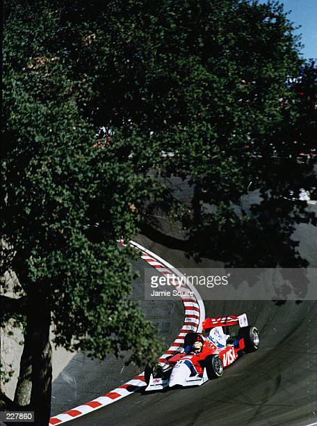 Mark Blundell of Great Britain powers his PacWest Reynard Ford 961 through the Corkscrew corner during practice for the Bank of America 300 at the...