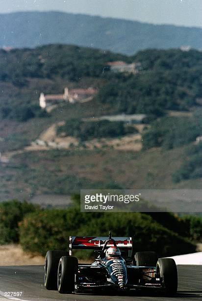 Michael Andretti powers his Newman Haas Lola Ford T96/00 through the californian countryside during practice for the Bank of America 300 at the...