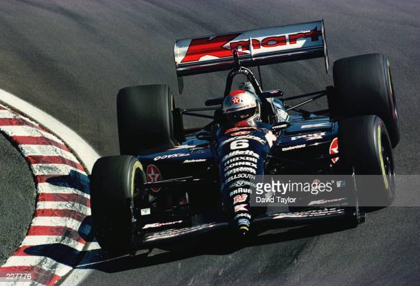 Michael Andretti takes his Newman Haas Lola Ford T96/00 through the Corkscrew corner during practice for the Bank of America 300 at the Monterey...