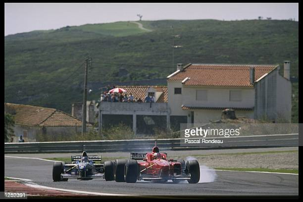 Michael Schumacher of Germany and the Ferrari team is put under pressure by an inspired Jacques Villeneuve of Williams during the Portuguese Grand...