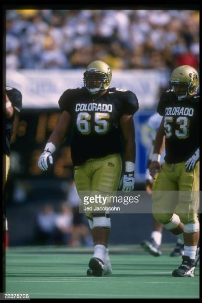 Offensive lineman Chris Naeole of the Colorado Buffaloes looks on during a game against the Michigan Wolverines at Folsom Field in Boulder Colorado...
