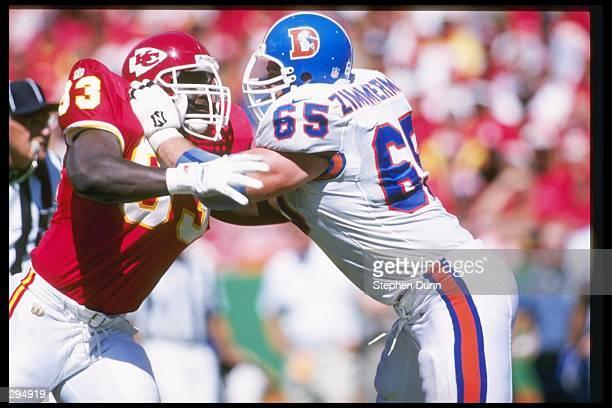 Offensive lineman Gary Zimmerman of the Denver Broncos blocks Kansas City Chiefs defensive lineman John Browning during a game at Arrowhead Stadium...