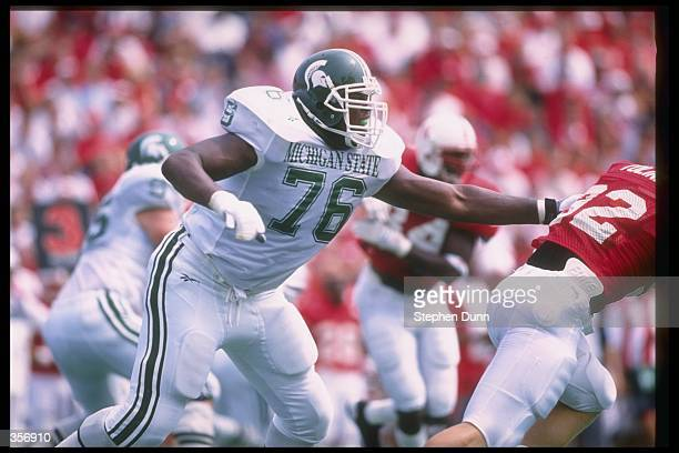 Offensive tackle Flozell Adams of the Michigan State Spartans looks to block a Nebraska Cornhuskers player during a game at Memorial Stadium in...