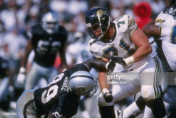 Offensive tackle Tony Boselli of the Jacksonville Jaguars blocks defensive tackle Aundray Bruce of the Oakland Raiders during the Jaguars 173 loss to...