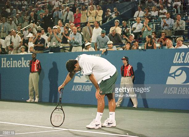 Pete Sampras takes a second during his match with Alex Corretja of Spain at the US Open in Flushing Meadows New York