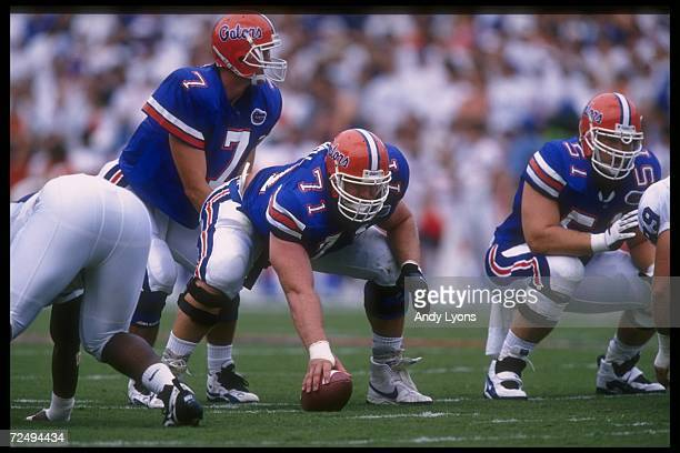 Quarterback Danny Wuerffel of the Florida Gators stands behind center Jeff Mitchell during a game against the Kentucky Wildcats at Florida Field in...