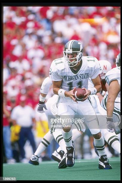 Quarterback Gus Ornstein of the Michigan State Spartans drops back during a game against the Nebraska Cornhuskers at Memorial Stadium in Lincoln...