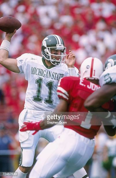 Quarterback Gus Ornstein of the Michigan State Spartans looks down field for an open receiver as he sets his feet to throw during the Spartans 5514...