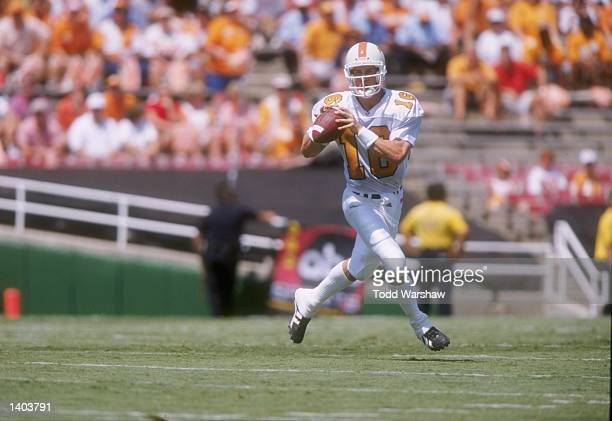 Quarterback Peyton Manning of the Tennessee Volunteers rolls out of the pocket during the Volunteers 3024 victory over the UCLA Bruins at the Rose...