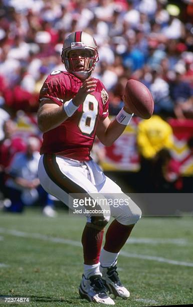 Quarterback Steve Young of the San Francisco 49ers looks down field for an open receiver as he sets his feet to throw a pass during the 49ers 340...
