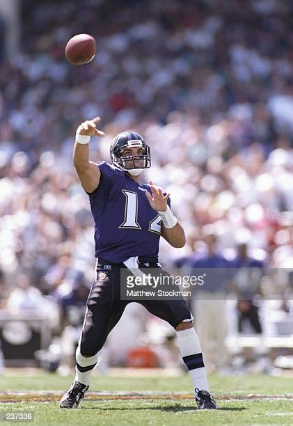Quarterback Vinny Testaverde of the Baltimore Ravens looks down field at an open receiver as he releases a pass during the Ravens 1914 victory over...