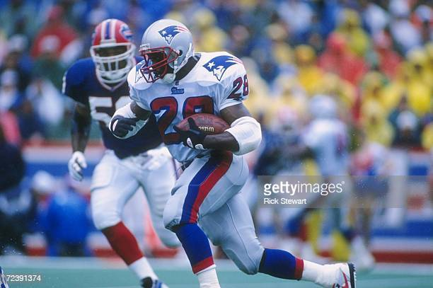Running back Curtis Martin of the New England Patriots looks up field as he makes a cut to the outside to avoid pursuing defenders from the Buffalo...