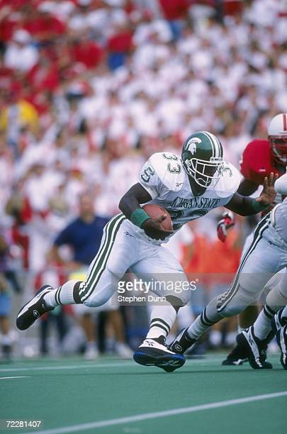 Running back Sedrick Irvin of the Michigan State Spartans makes a cut to the inside as he follows his lead blockers during a carry in the Spartans...