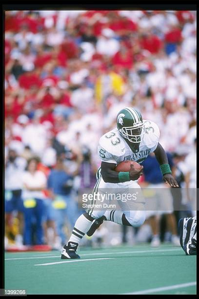 Running back Sedrick Irvin of the Michigan State Spartans runs down the field during a game against the Nebraska Cornhuskers at Memorial Stadium in...