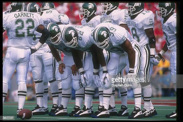The Michigan State Spartans huddle up during a game against the Nebraska Cornhuskers at Memorial Stadium in Lincoln Nebraska Nebraska won the game...
