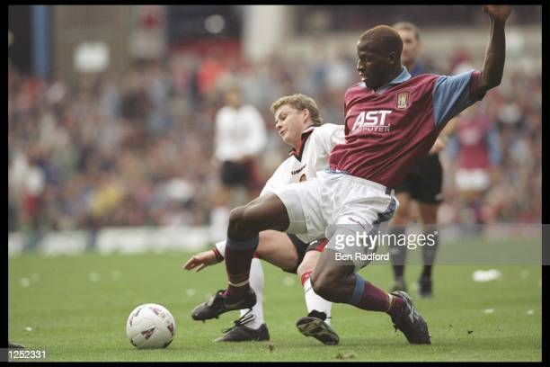 Ugo Ehiogu of Aston Villa is tackled by Ole Gunnar Solskjaer of Manchester United during the FA Carling Premiership match between Aston Villa and...