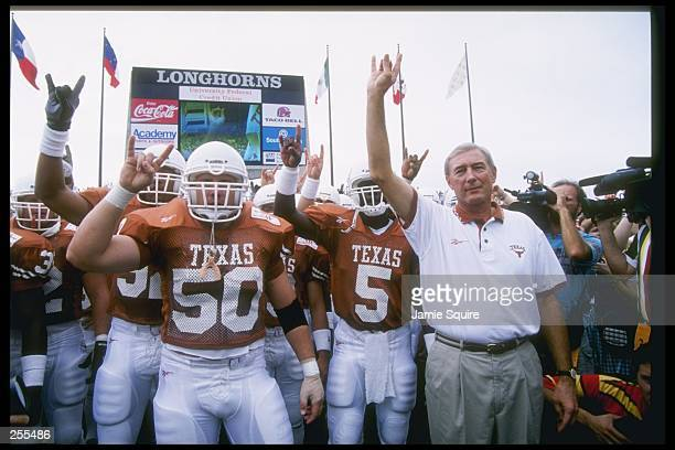 University of Texas Longhorns linebacker Tyson King and head coach John Mackovic prepare to lead the team onto the field prior to game against the...
