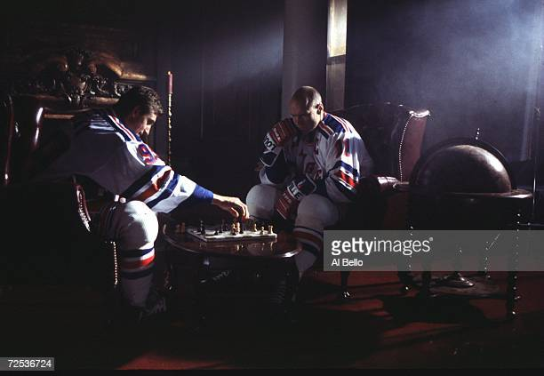 Wayne Gretzky and Mark Messier of the New York Rangers play chess during the shooting of a FOX television commercial in New York City New York...