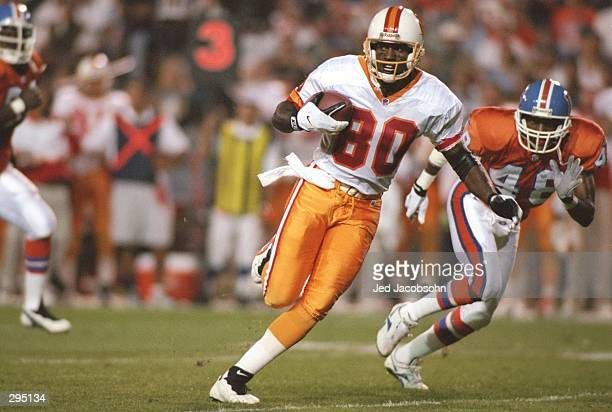 Wide receiver Alvin Harper of the Tampa Bay Buccaneers moves the ball during a game against the Denver Broncos at Mile High Stadium in Denver,...