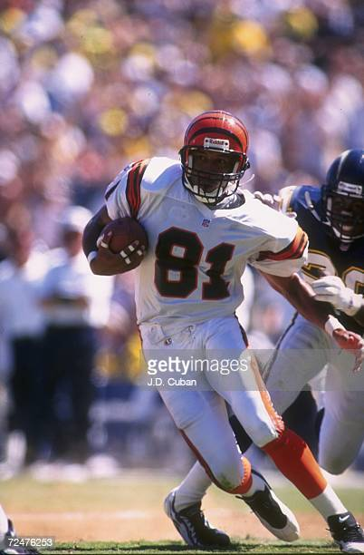 Wide receiver Carl Pickens of the Cincinnati Bengals carries the ball following a reception during the Bengals 2714 loss to the San Diego Chargers at...
