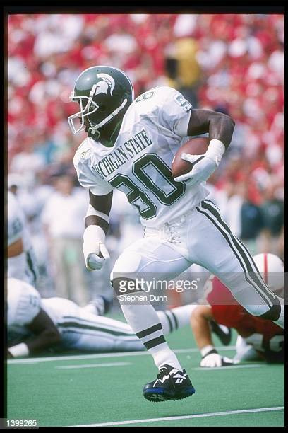 Wide receiver Derrick Mason of the Michigan State Spartans runs down the field during a game against the Nebraska Cornhuskers at Memorial Stadium in...