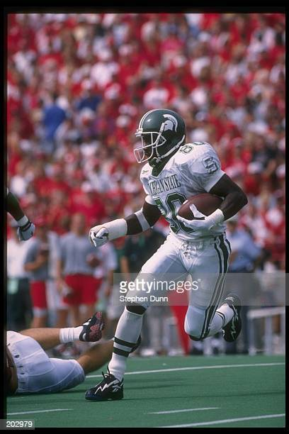 Wide receiver Derrick Mason of the Michigan State Spartans runs with the ball during a game against the Nebraska Cornhuskers at Memorial Stadium in...