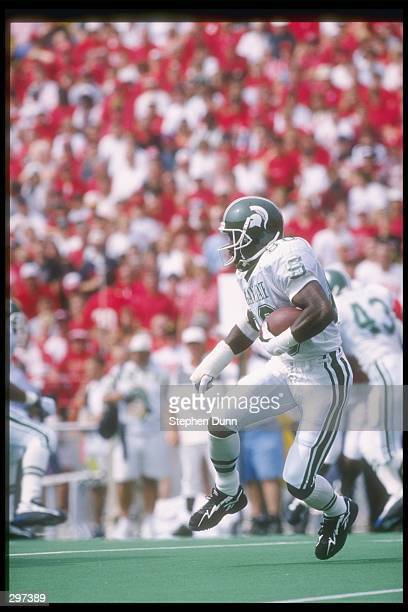 Wide receiver Derrick Mason of the Michigan State Spartans runs with the ball during a game against the Nebraska Cornhuskers at the Memorial Stadium...