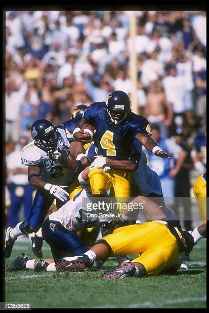 Wide receiver Na''il Benjamin of the California Golden Bears breaks through several Nevada Wolf Pack tacklers during a game at Memorial Stadium in...