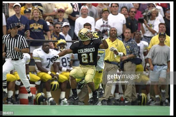 Wide receiver Rae Carruth of the Colorado Buffaloes looks to catch the ball during a game against the Michigan Wolverines at Folsom Field in Boulder...