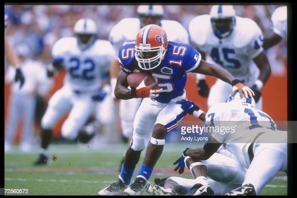 Wide receiver Reidel Anthony of the Florida Gators breaks the tackle of a Kentucky Wildcats player during a game at Florida Field in Gainesville...