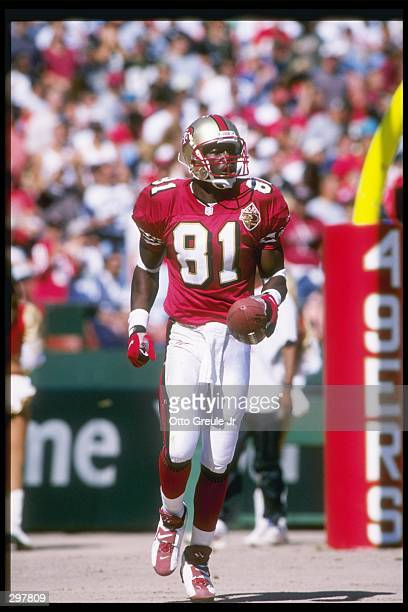 Wide receiver Terrell Owens of the San Francisco 49ers moves down the field during a game against the New Orleans Saints at 3Com Park in San...