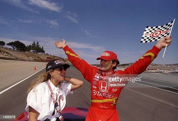 Alex Zanardi of Italy celebrates with his wife Daniella during the Toyota Grand Prix of Monterey in Laguna Seca, California. Mandatory Credit: David...