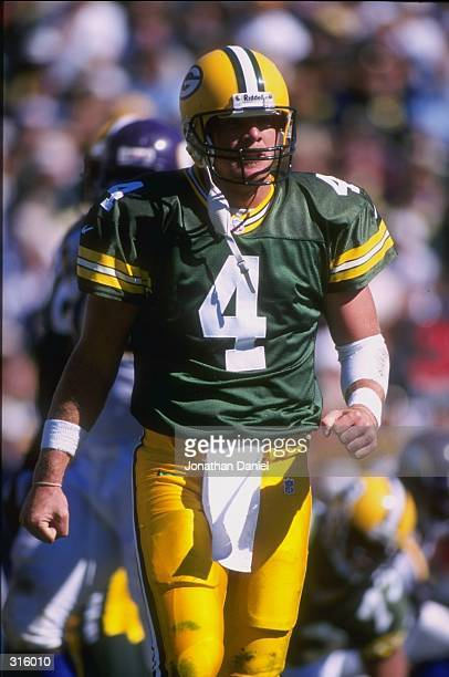 Brett Favre of the Green Bay Packers looks on during a game against the Minnesota Vikings at Lambeau Field in Green Bay Wisconsin The Packers...
