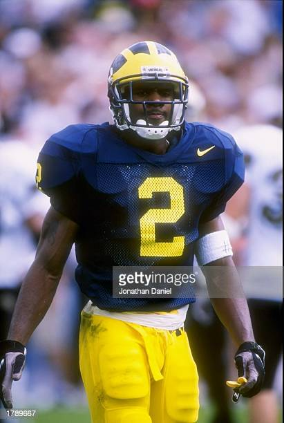 Cornerback Charles Woodson of the Michigan Wolverines stands on the field during a game against the Colorado Buffaloes at Michigan Stadium in Ann...