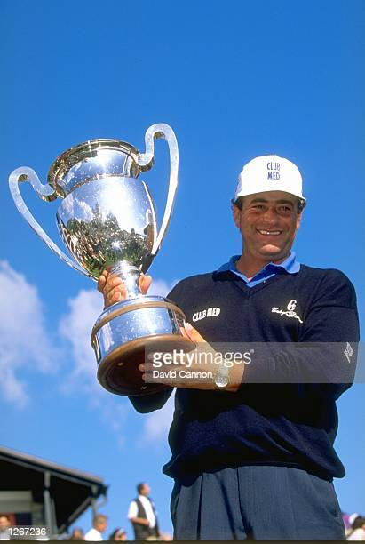 Costantino Rocca of Italy holds the trophy aloft after winning the Canon European Masters at the Crans Sur Sierre Golf Club in Switzerland Mandatory...