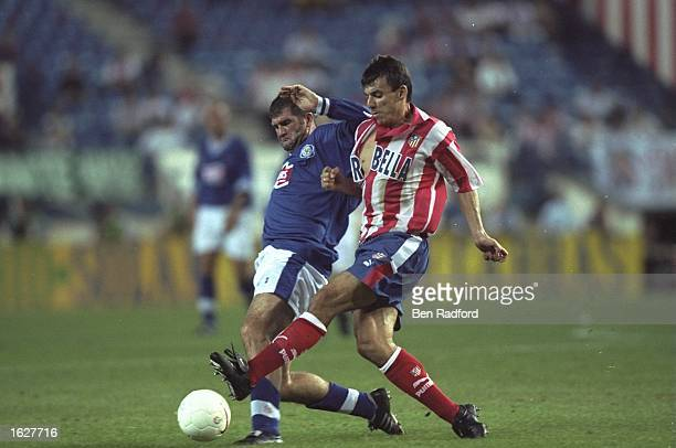Dan Prodan of Athletico Madrid and Ian Marshall of Leicester City struggle for possession of the ball during the UEFA Cup First Round match at the...