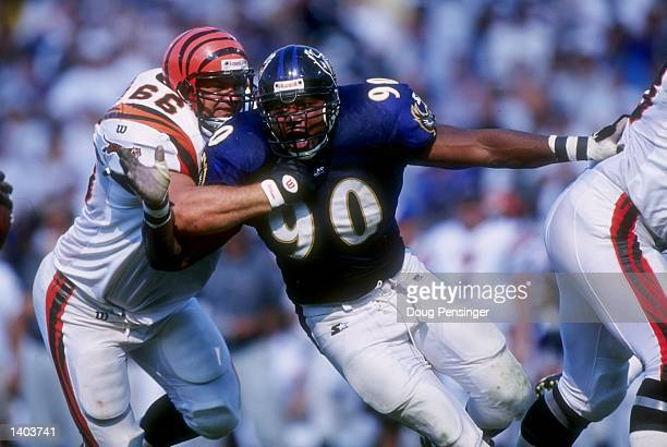 Defenise lineman Rob Burnett of the Baltimore Ravens battles offensive lineman Ken Blackman of the Bengals during the Ravens 2310 win over the...