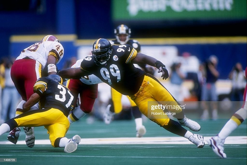 Defensive lineman Levon Kirkland #99 of the Pittsburgh Steelers dives for running back Stephen Davis #48 of the Redskins during the Steelers 14-13 win over the Washington Redskins at Three Rivers Stadium in Pittsburgh, Pennsylvania. Mandatory Credit: Robert Laberge /Allsport